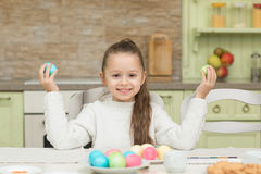 Funny little girl with two Easter eggs stock image