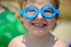 Funny little girl in water glasses Stock Photo