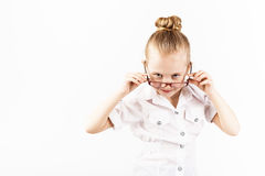 Funny little girl wearing eyeglasses imitates a strict teacher a Royalty Free Stock Photo