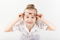 Funny little girl wearing eyeglasses imitates a strict teacher a Stock Photos