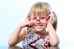 Funny little girl wearing glasses. Royalty Free Stock Photography