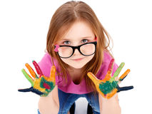 Funny little girl wearing glasses playing with water colors Stock Photography