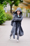 Funny little girl wearing her fathers' coat Royalty Free Stock Photo