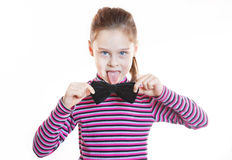 Funny little girl wearing striped blouse and black bow-tie Royalty Free Stock Images