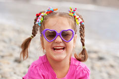 Funny little girl wearing a sunglasses Stock Images