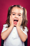 Funny Little Girl wit Surprise Expression Royalty Free Stock Image