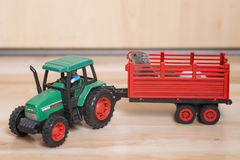 Funny little hamsters ride on toy tractor. Stock Photography