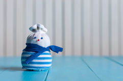 Funny little handmade snowman in a blue stripy Royalty Free Stock Photography