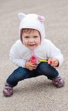 Funny little happy girl playing outdoors. With soap bubbles royalty free stock photo
