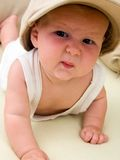 Funny little hooligan. Funny baby in a big cap Stock Photo