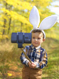 Funny little kid boy with Easter bunny ears taking a selfie Royalty Free Stock Photography