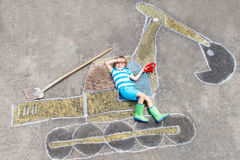 Funny little kid boy with excavator chalk picture Royalty Free Stock Image