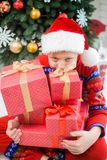 Funny little kid dressed in red night-suit and hat of santa Stock Images