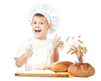 Funny little kid is kneading dough Stock Image