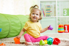 Funny little kid playing with toys Royalty Free Stock Photography