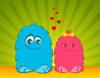 Funny little loving monsters Royalty Free Stock Images
