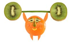 Funny little man made ??of fruits and vegetables raises bar. Stock Photo
