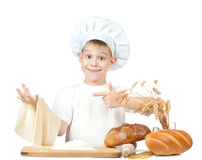 Funny little master chef is kneading dough Stock Image