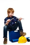 Funny little mechanic boy Stock Images