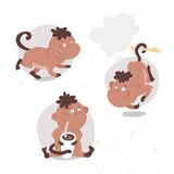 Funny little monkey drinks cocoa Royalty Free Stock Images