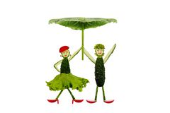 Funny little people made ??of cucumber under an umbrella Stock Photo
