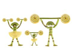 Funny little people made of the kiwi slices. Stock Image