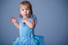 Funny little princess. Small baby girl in blue fairy costume royalty free stock images