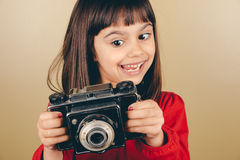 Funny little retro photographer girl Royalty Free Stock Image