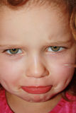 Funny little sad mouth. Little girl doing a funny sad mouth Stock Images