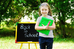 Funny little schoolgirl feeling excited about going back to scho. Ol Royalty Free Stock Image