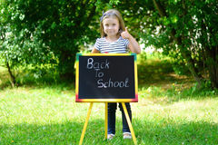 Funny little schoolgirl feeling excited about going back to school. Funny schoolgirl feeling excited about going back to school Royalty Free Stock Image