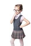 Funny little schoolgirl in glasses Stock Image
