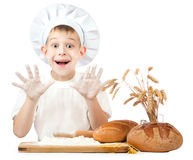Funny little scullion is kneading dough Royalty Free Stock Image