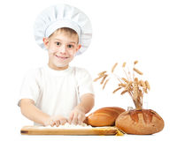 Funny little scullion is kneading dough Stock Photo