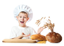 Funny little scullion is kneading dough Royalty Free Stock Photos