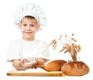 Funny little scullion is kneading dough Stock Photos