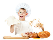 Funny little scullion is kneading dough Royalty Free Stock Images