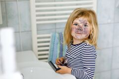 Free Funny Little Toddler Girl Using Mother`s Make Up And Painting Face With Eye Shadows. Happy Baby Child Making Experiments Royalty Free Stock Photography - 193376927