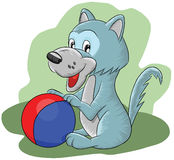 Funny little wolf playing ball Royalty Free Stock Image