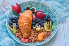 Lobster Croissant with berries for kids breakfast Stock Photography