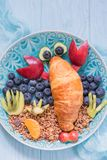 Lobster Croissant with berries for kids breakfast Stock Photo