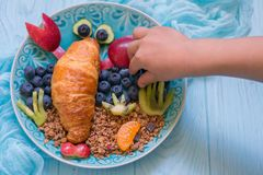 Lobster Croissant with berries for kids breakfast Stock Image