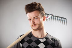 Funny looking guy with red-haired with a rake Royalty Free Stock Photography
