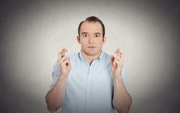 Funny looking guy, sarcastic, anxious business man crossing fingers Royalty Free Stock Photo