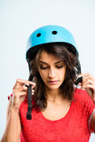 Funny woman wearing cycling helmet portrait real people high def Stock Photo