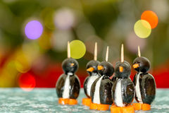 Funny-looking penguins with olives, cheese and carrots Stock Images
