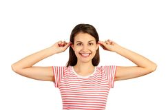 Funny-looking woman grimacing making ears protruding. emotional girl isolated on white background Royalty Free Stock Photos