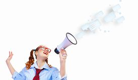 Funny looking woman with megaphone Stock Images