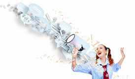 Funny looking woman with megaphone Royalty Free Stock Photos