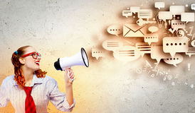 Funny looking woman with megaphone Royalty Free Stock Image